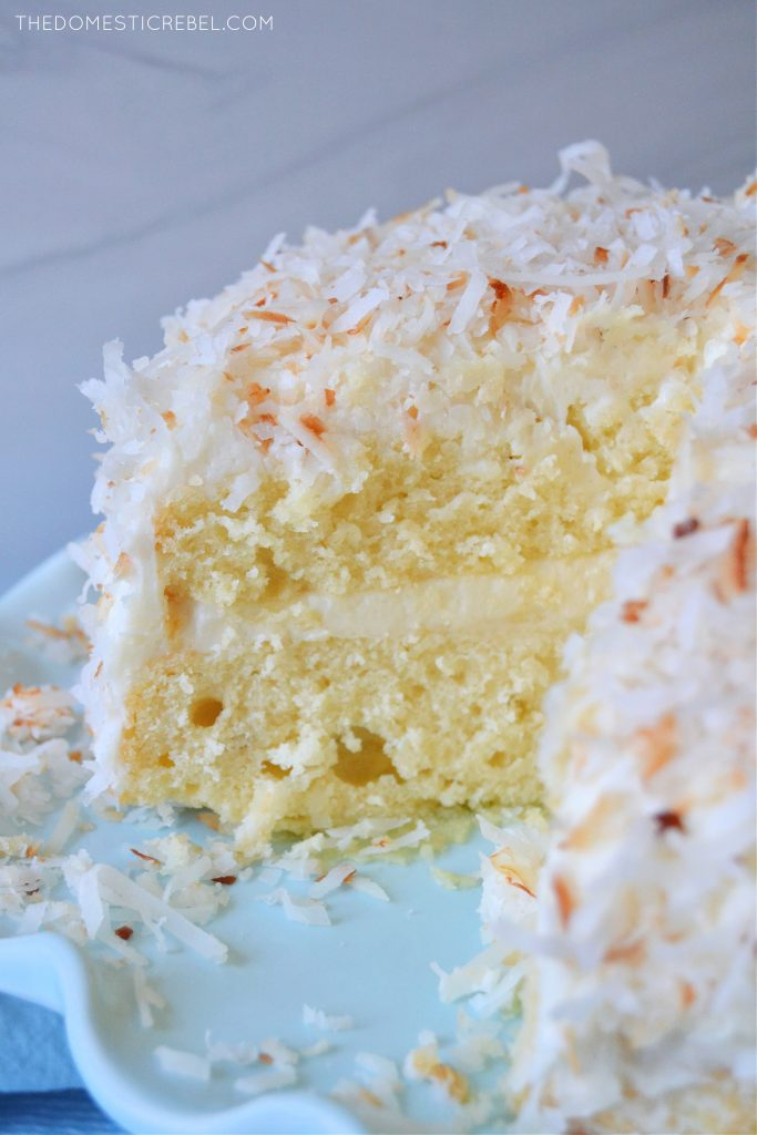 coconut layer cake on a blue pedestal