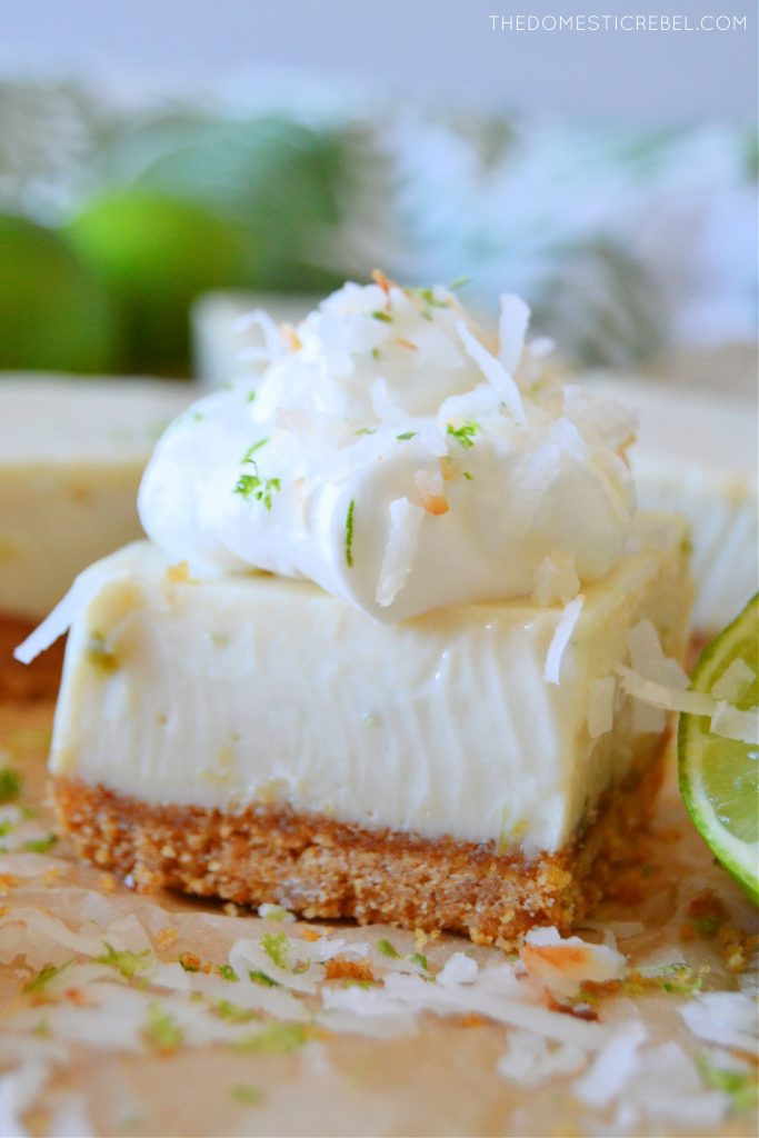 closeup of a key lime pie bar with whipped cream