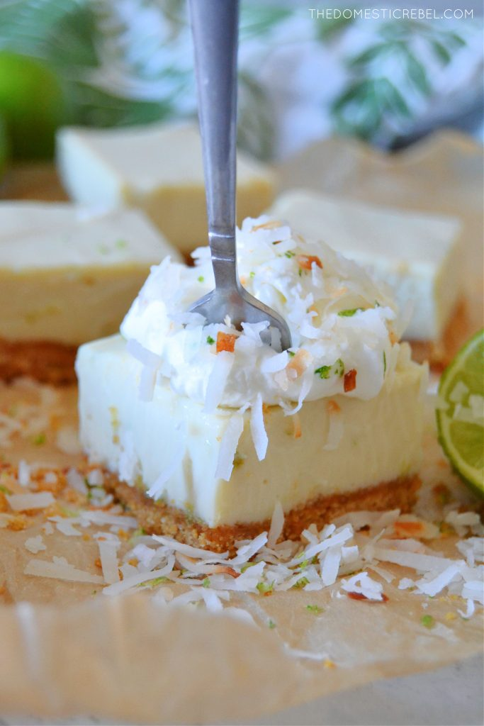 key lime pie bar with a fork in it