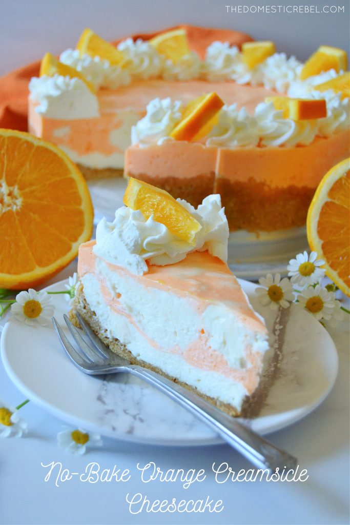 orange creamsicle cheesecake on a white plate with a fork