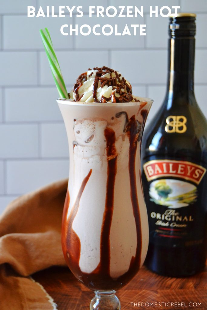 baileys frozen hot chocolate in a tall glass with green straw