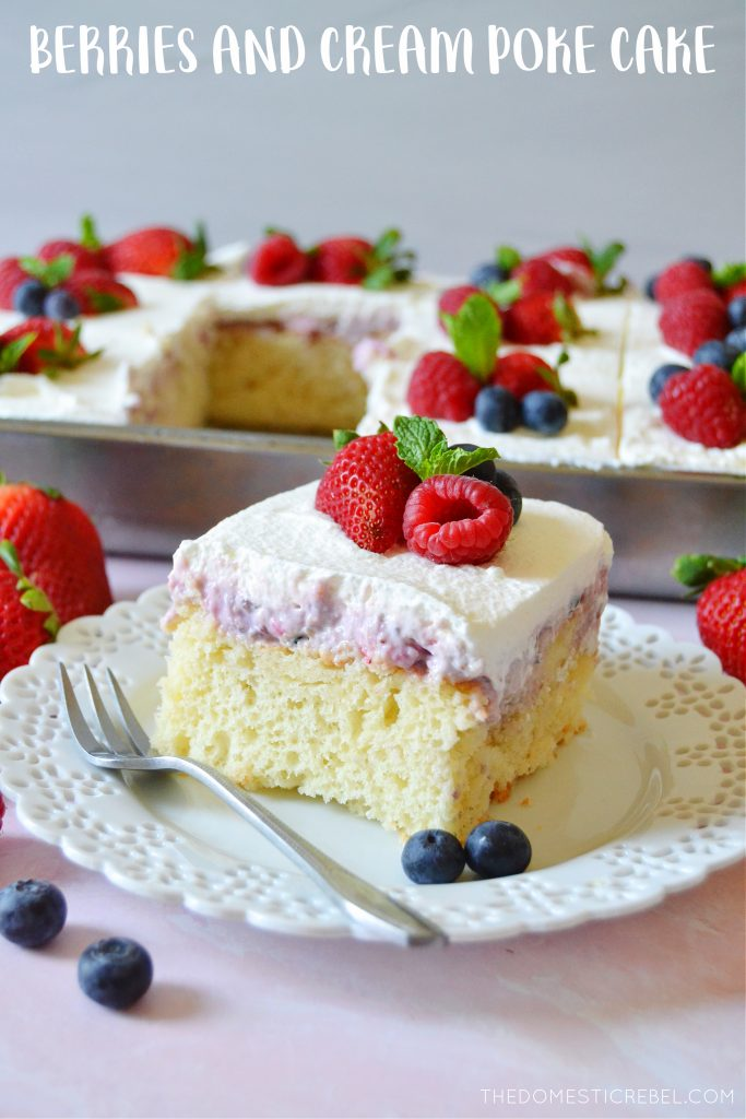 a piece of berries and cream poke cake on a little white plate with a fork