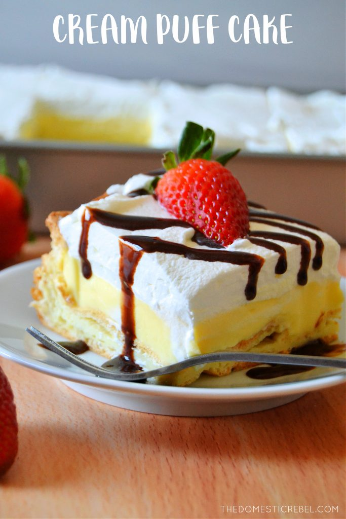 cream puff cake slice on a white plate with a fork