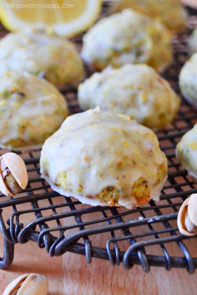 pistachio lemon cookie on a wire rack with a pistachio nut