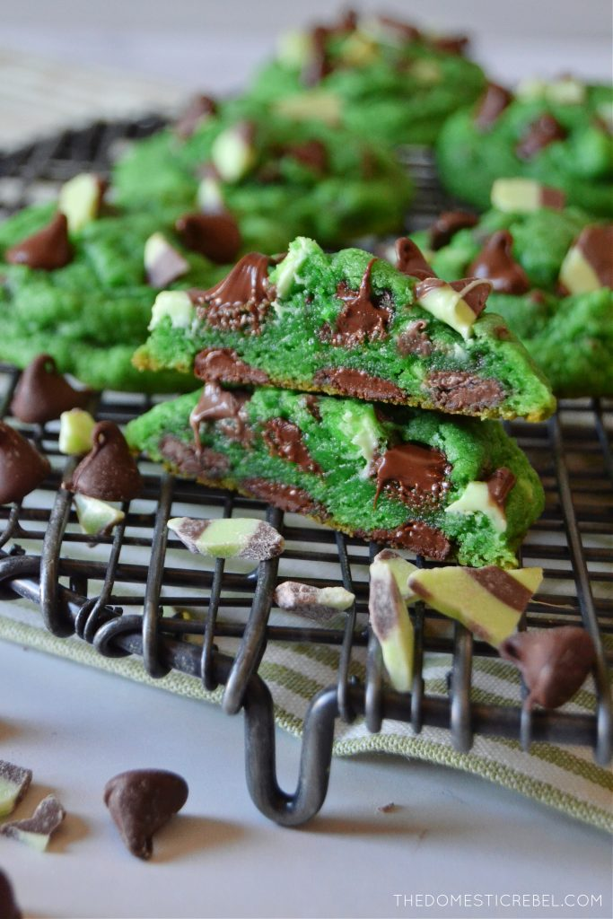 mint chocolate chip cookies stacked on a wire rack