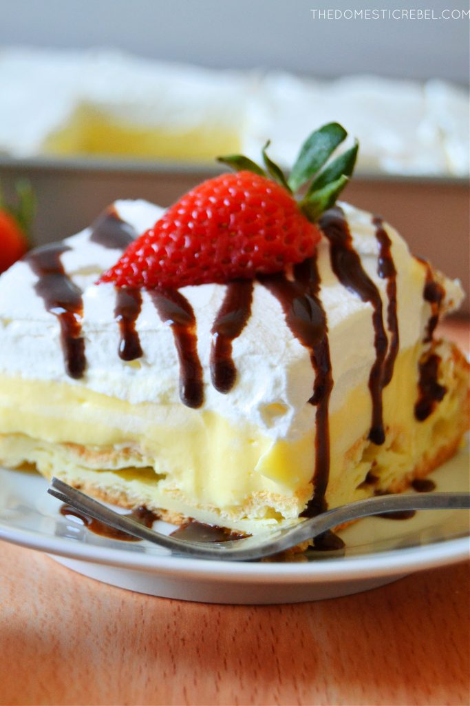 cream puff cake slice with chocolate sauce dripping down the sides