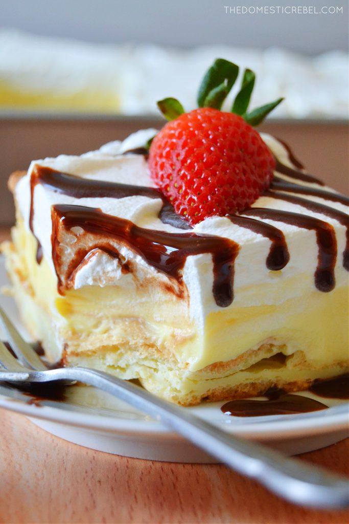closeup of a cream puff cake slice with a bite missing