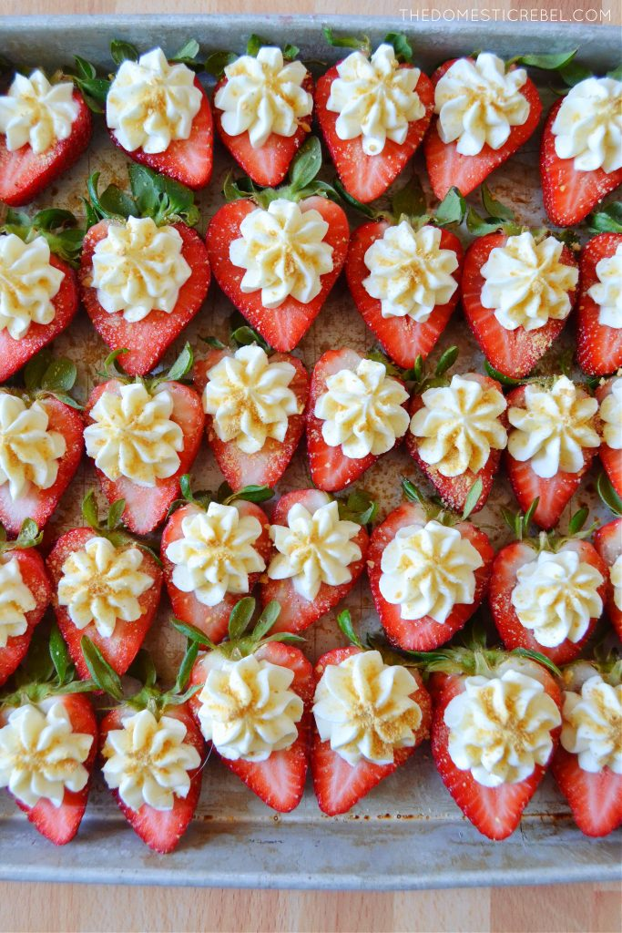a pan filled with cheesecake deviled strawberries