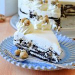 cookie dough icebox oreo cake on a blue and white fluted plate with a fork