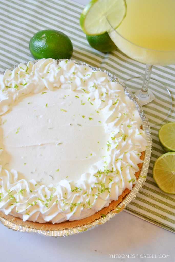 a beautiful margarita pie with limes around it
