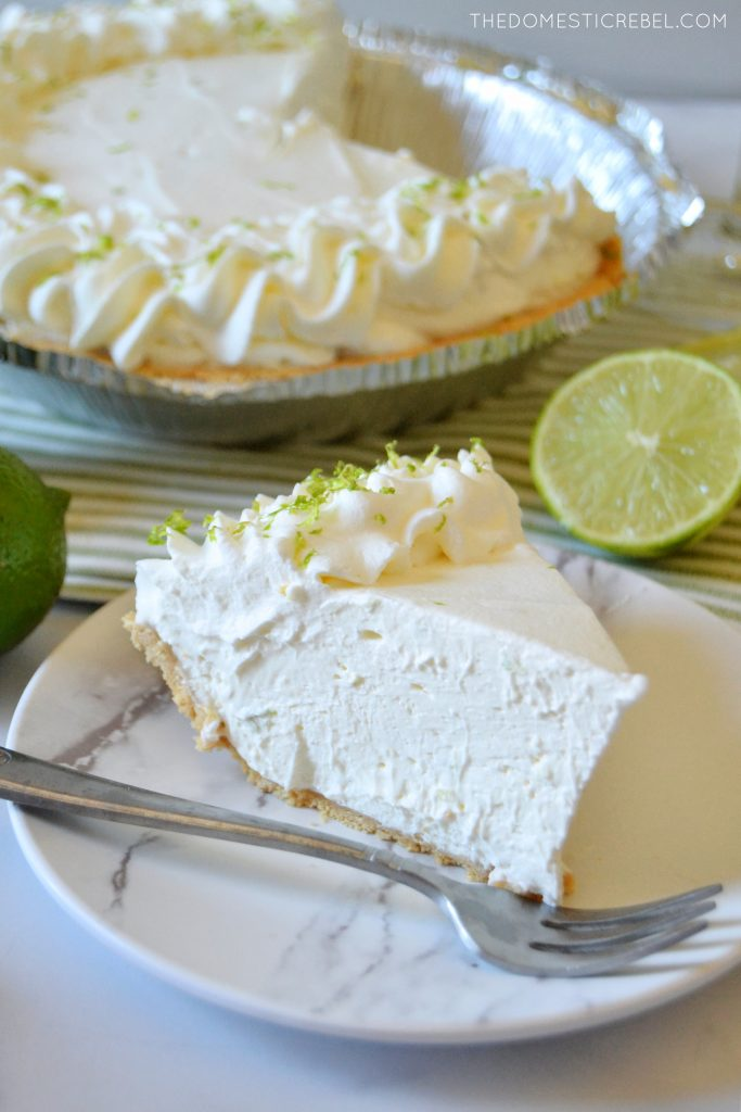 a piece of margarita pie on a white plate with a whole pie in the background