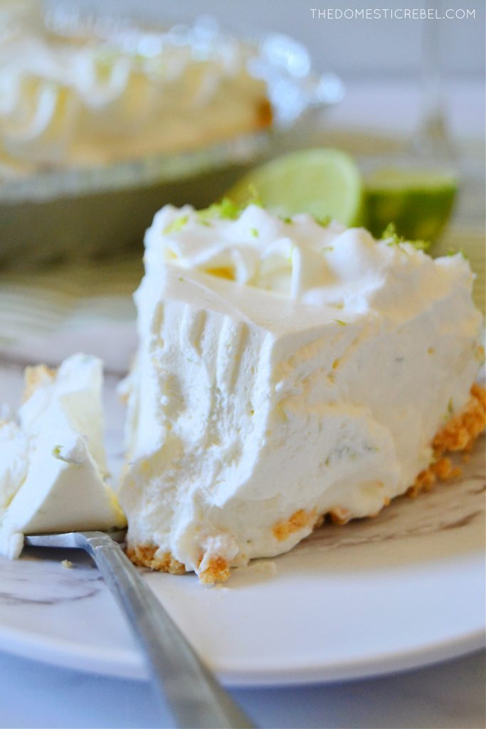 a closeup slice of a margarita pie with a bite missing
