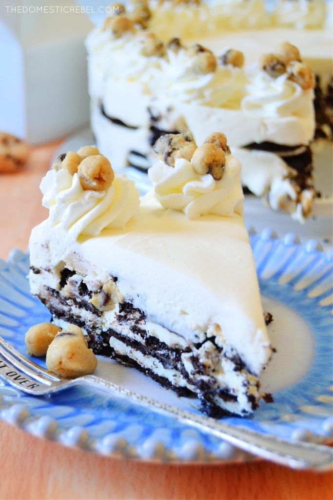 closeup slice of cookie dough oreo icebox cake on blue plate with silver fork
