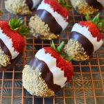 s'mores dipped strawberries on a wire rack and sheet pan