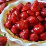 a strawberry pie in a white ceramic dish