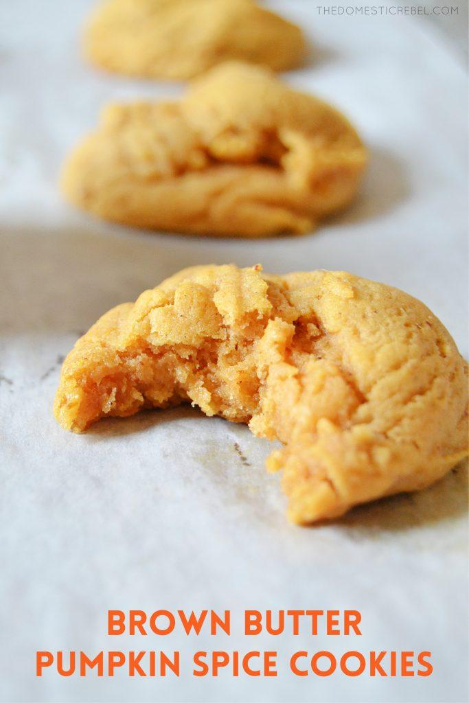a bitten brown butter pumpkin spice cookie on a piece of white parchment