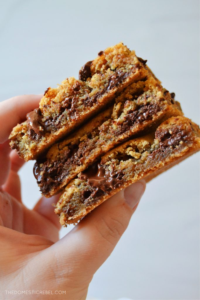 author holding a trio stack of chocolate chip cookie bars