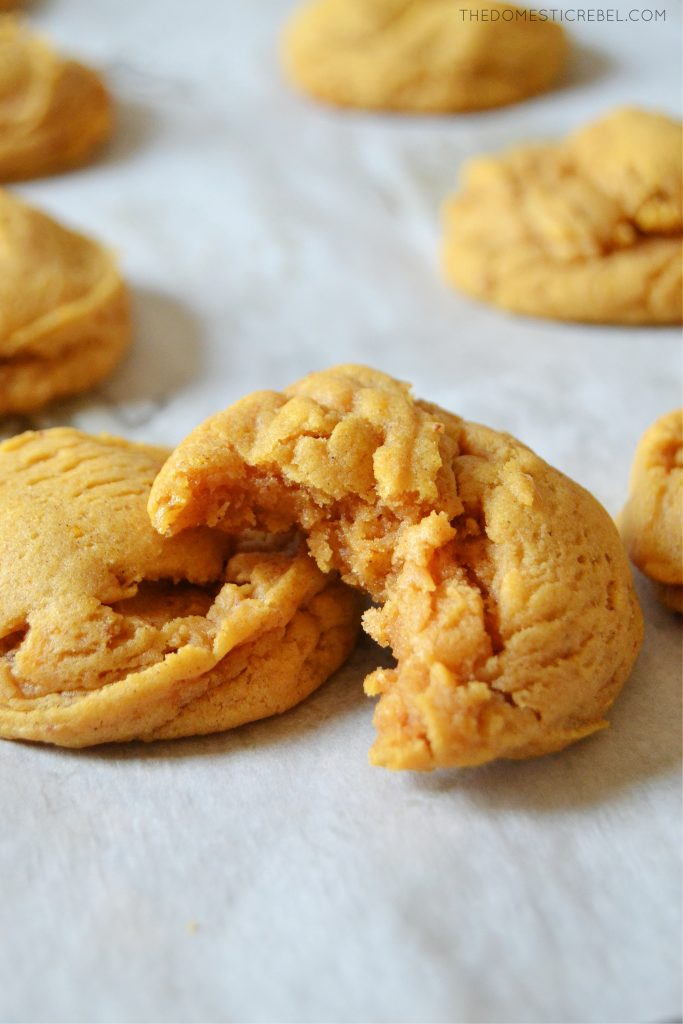 two brown butter pumpkin spice cookies on a piece of parchment
