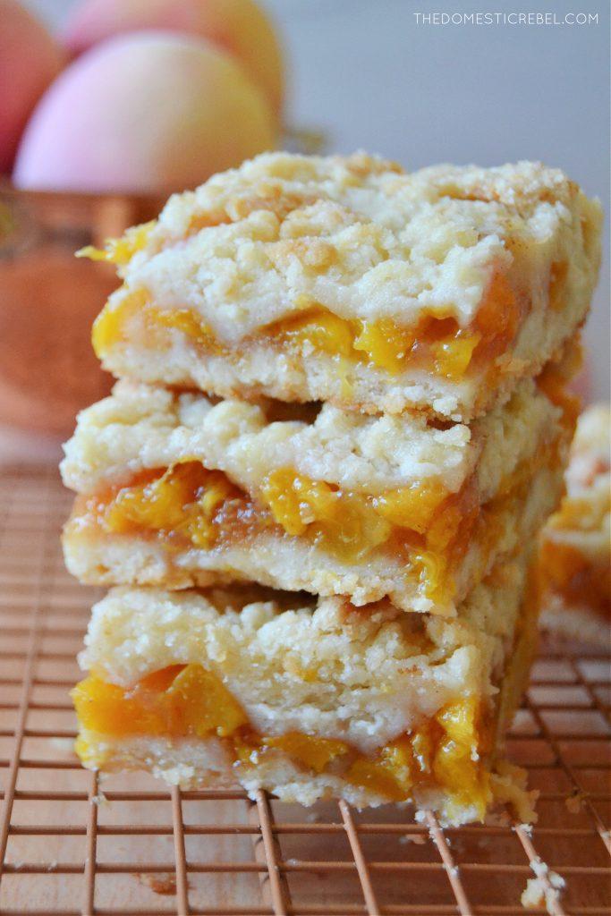 a closeup trio stack of peach crumble bars