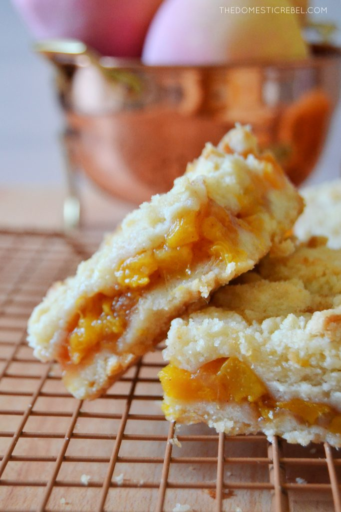 a peach crumble bar resting on another bar