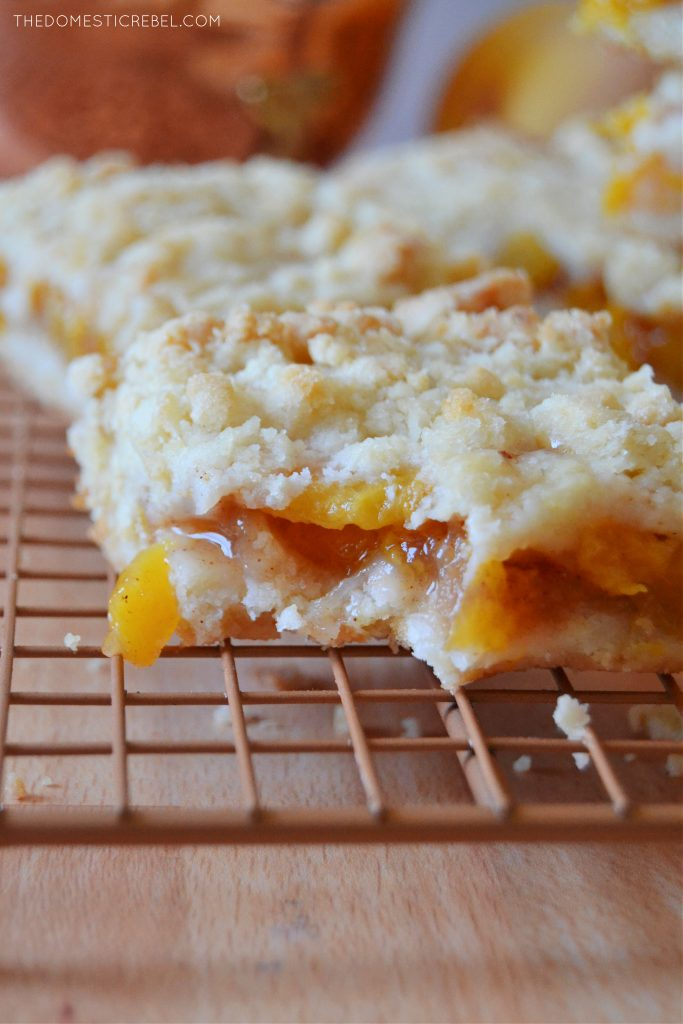 closeup of a peach crumble bar with a bite missing