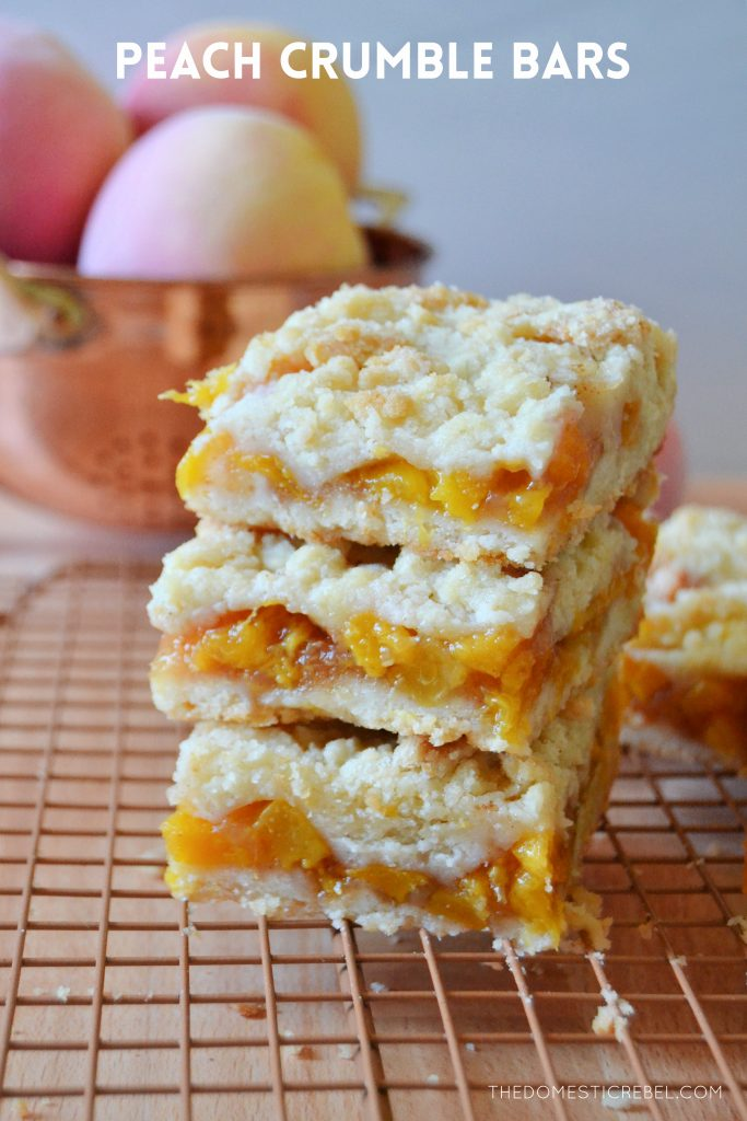 a stack of three peach crumble bars on a wire rack