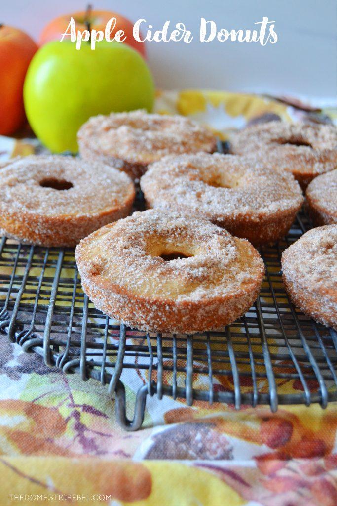 apple cider donuts on a black cooling rack