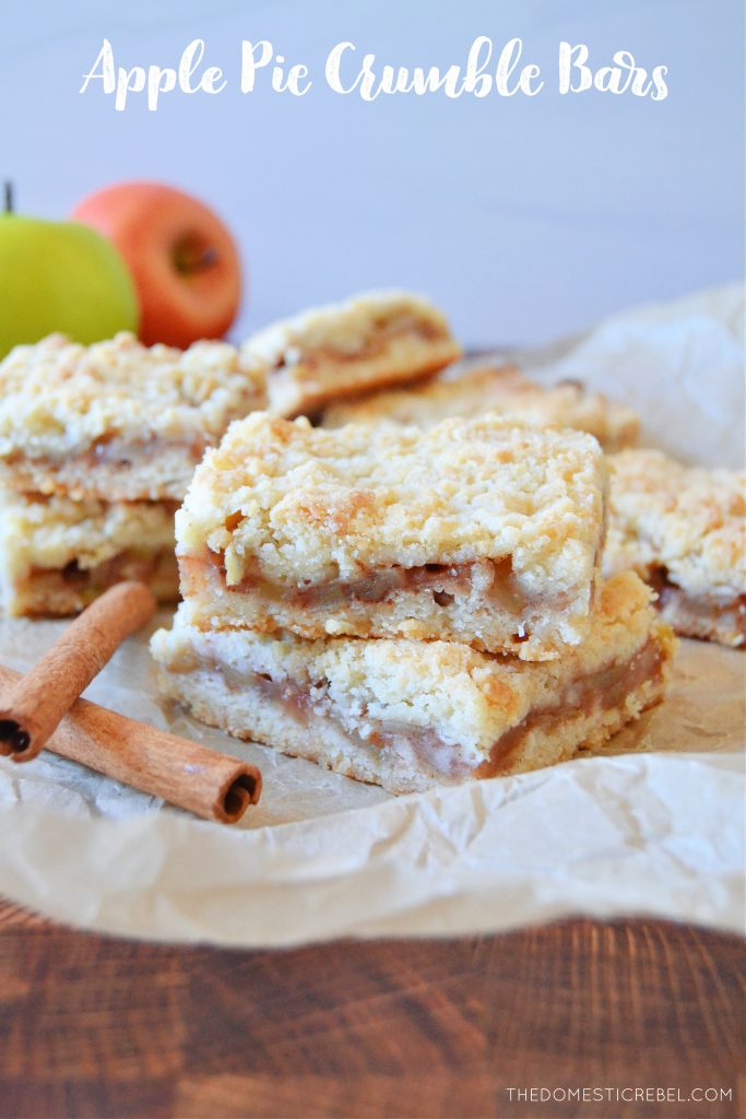 a double stack of apple pie crumble bars on parchment with cinnamon sticks