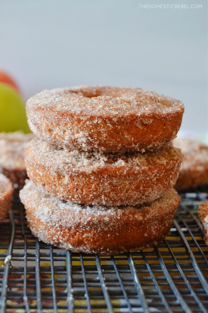 a vertical trio stack of apple cider donuts on a wire rack