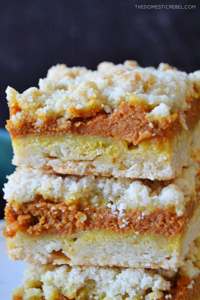 a closeup vertical stack of pumpkin pie crumble bars
