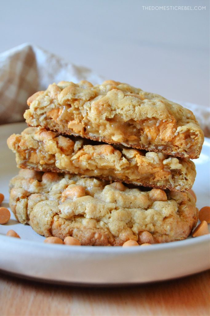 a stack of split open oatmeal scotchie cookies on a white rimmed plate