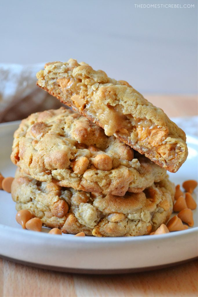 a stack of oatmeal scotchie cookies with one split open