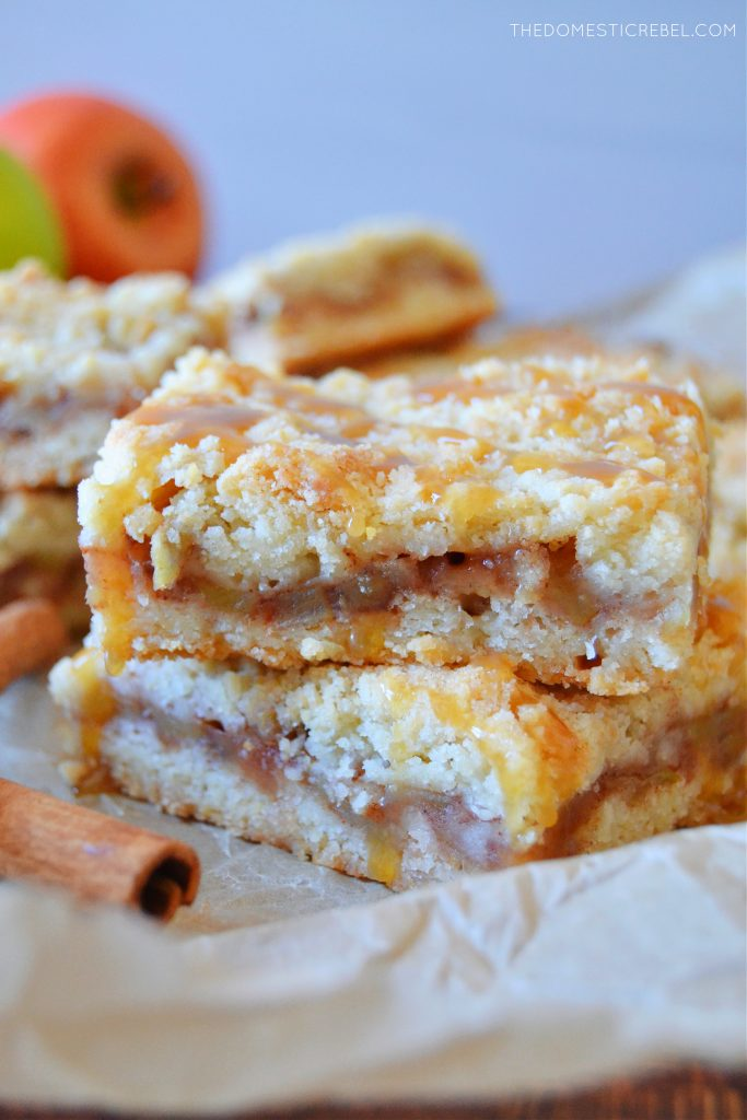 a double stack of apple pie crumble bars drizzled with caramel sauce