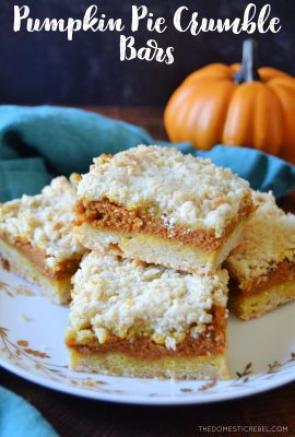 a plate of pumpkin pie crumble bars on a teal towel