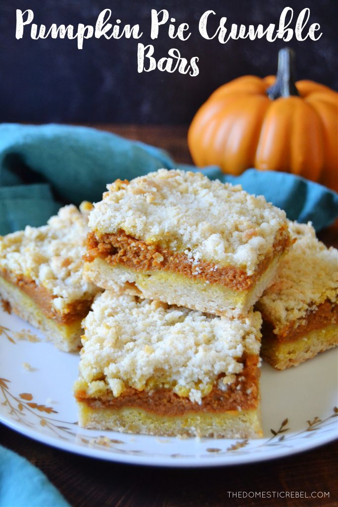 a plateful of pumpkin pie crumble bars on a white plate with a teal towel